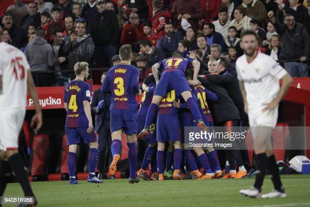 Lionel Messi of FC Barcelona celebrates 22 with team mates during the La Liga Santander match between Sevilla v FC Barcelona at the Estadio Ramon...