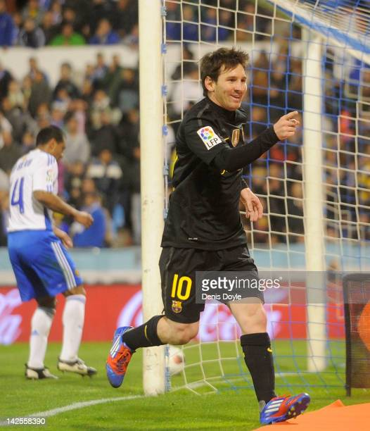 Lionel Messi of FC Barcelona celebrates after he scored their 3rd goal during the La Liga match between Real Zaragoza and FC Barcelona at La Romareda...
