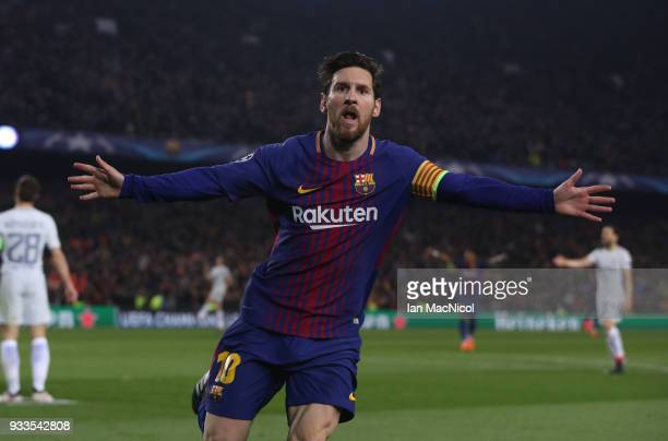 Lionel Messi of FC Barcelona celebrates after he scores his team's third goal and his 100th Champions League goal during the UEFA Champions League...