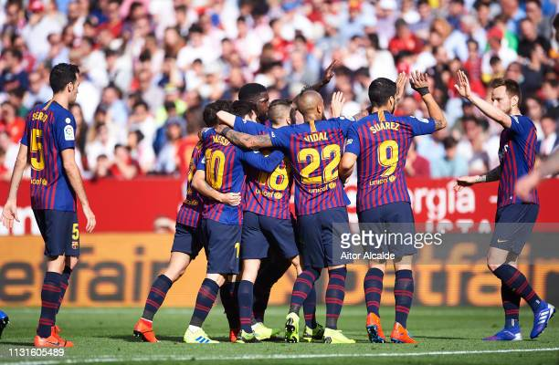 Lionel Messi of FC Barcelona celebrates after scoring a goal during the La Liga match between Sevilla FC and FC Barcelona at Estadio Ramon Sanchez...