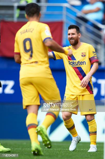 Lionel Messi of FC Barcelona celebrates after scoring a goal with Luis Suarez of FC Barcelona during the Liga match between SD Eibar SAD and FC...
