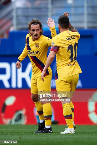 Lionel Messi of FC Barcelona celebrates after scoring a goal with Antoine Griezmann of FC Barcelona during the Liga match between SD Eibar SAD and FC...