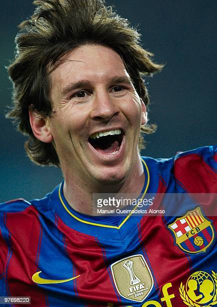 Lionel Messi of FC Barcelona celebrates after scoring during the La Liga match between Barcelona and Valencia at the Camp Nou Stadium on March 14...