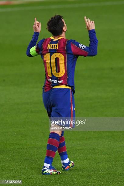 Lionel Messi of FC Barcelona celebrates after scoring his sides first goal during the UEFA Champions League Group G stage match between FC Barcelona...