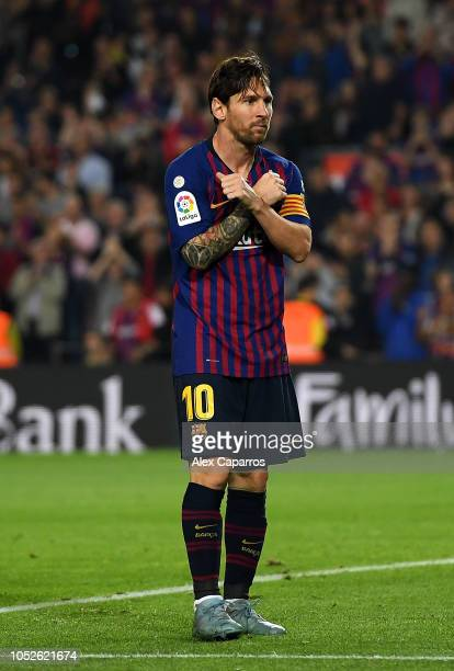 Lionel Messi of FC Barcelona celebrates after scoring his sides second goal during the La Liga match between FC Barcelona and Sevilla FC at Camp Nou...