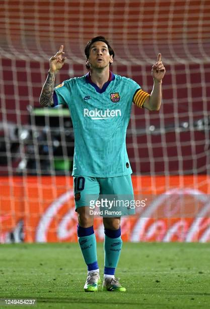 Lionel Messi of FC Barcelona celebrates after scoring his sides fourth goal during the La Liga match between RCD Mallorca and FC Barcelona at Estadio...