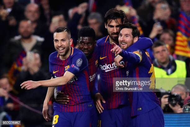 Lionel Messi of FC Barcelona celebrates after scoring his sides third goal with teammates Samuel Umtiti Andre Gomes and Jordi Alba during the UEFA...