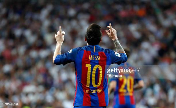 Lionel Messi of FC Barcelona celebrates after scoring his team goal during the La Liga match between Real Madrid CF and FC Barcelona at the Santiago...