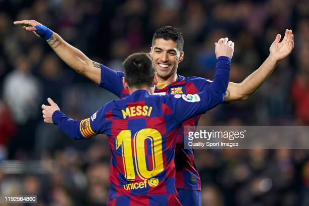 Lionel Messi of FC Barcelona celebrates after scoring his team's fifth goal with his tammate Luis Suarez during the La Liga match between FC...