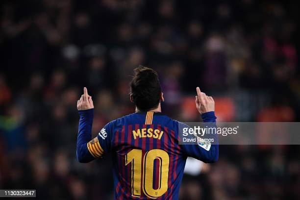 Lionel Messi of FC Barcelona celebrates after scoring his team's first goal during the La Liga match between FC Barcelona and Real Valladolid CF at...