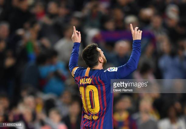 Lionel Messi of FC Barcelona celebrates after scoring his team's first goal during the La Liga match between FC Barcelona and Levante UD at Camp Nou...