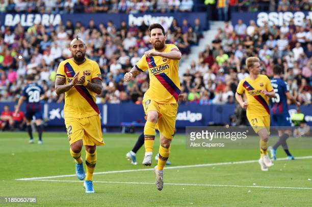 Lionel Messi of FC Barcelona celebrates after scoring his team's first goal during the Liga match between Levante UD and FC Barcelona at Ciutat de...
