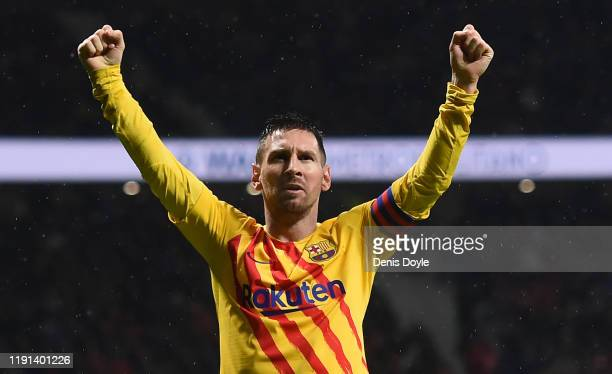 Lionel Messi of FC Barcelona celebrates after scoring his team's first goal during the Liga match between Club Atletico de Madrid and FC Barcelona at...
