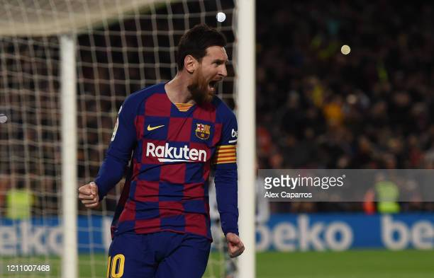 Lionel Messi of FC Barcelona celebrates after scoring his team's first goal during the La Liga match between FC Barcelona and Real Sociedad at Camp...