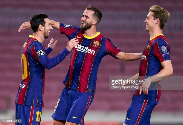 Lionel Messi of FC Barcelona celebrates after scoring his team's first goal with his teammates Miralem Pjanic and Frenkie de Jong during the UEFA...