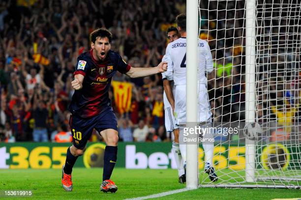 Lionel Messi of FC Barcelona celebrates after scoring his team's first goal during the La Liga match between FC Barcelona and Real Mdrid CF at Camp...