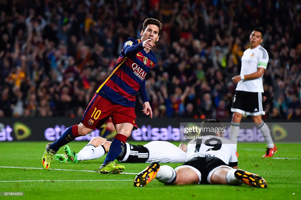 Lionel Messi of FC Barcelona celebrates after scoring his team's first goal during the La Liga match between FC Barcelona and Valencia CF at Camp Nou on April 17, 2016 in Barcelona, Spain.