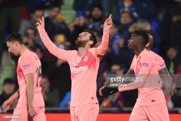 Lionel Messi of FC Barcelona celebrates after scoring his team's opening goal during the La Liga match between Getafe CF and FC Barcelona at Coliseum...