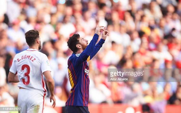 Lionel Messi of FC Barcelona celebrates after scoring his team's second goal during the La Liga match between Sevilla FC and FC Barcelona at Estadio...