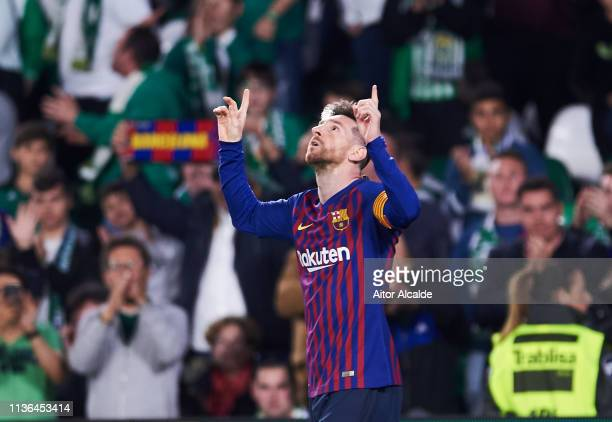 Lionel Messi of FC Barcelona celebrates after scoring his team's fourth goal during the La Liga match between Real Betis Balompie and FC Barcelona at...