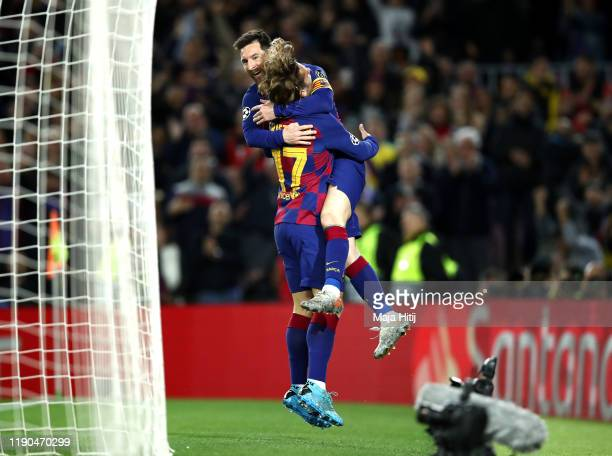 Lionel Messi of FC Barcelona celebrates after scoring his team's second goal with teammate Antoine Griezmann during the UEFA Champions League group F...