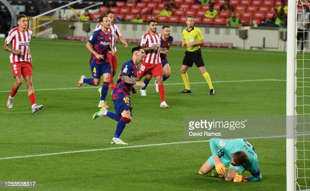 Lionel Messi of FC Barcelona celebrates after scoring his team's second goal by penalty against Goalkeeper Jan Oblak of Atletico Madrid during the...