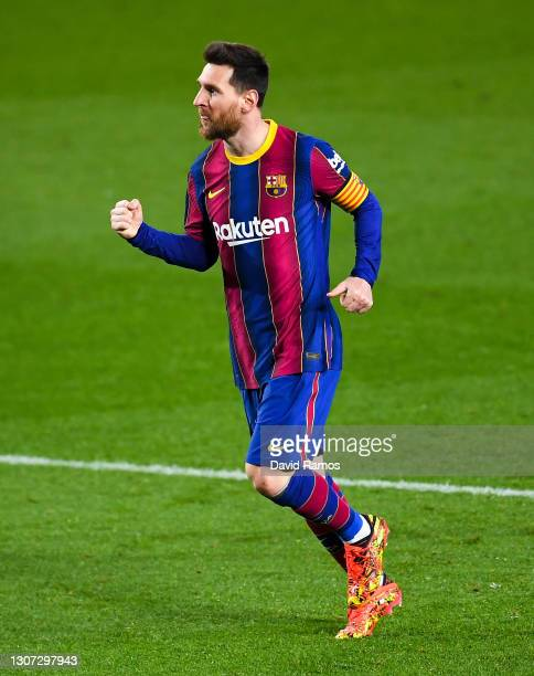 Lionel Messi of FC Barcelona celebrates after scoring his team's fourth goal during the La Liga Santander match between FC Barcelona and SD Huesca at...