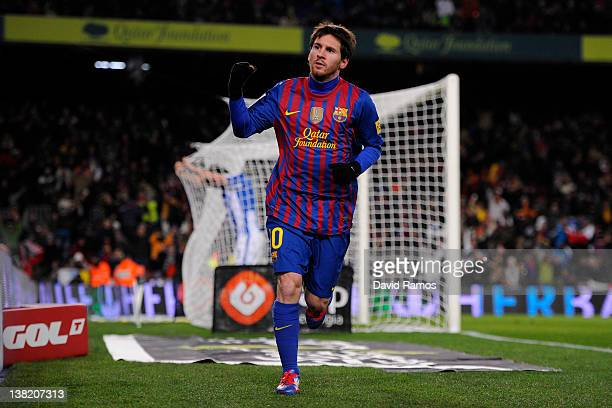 Lionel Messi of FC Barcelona celebrates after scoring his team's second goal during the La Liga match between FC Barcelona and Real Sociedad de...