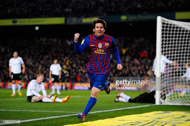 Lionel Messi of FC Barcelona celebrates after scoring his team's second goal during the La Liga match between FC Barcelona and Valencia CF at Camp...