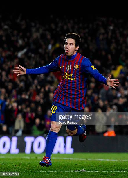Lionel Messi of FC Barcelona celebrates after scoring his team's fourth goal during the La Liga match between FC Barcelona and Valencia CF at Camp...