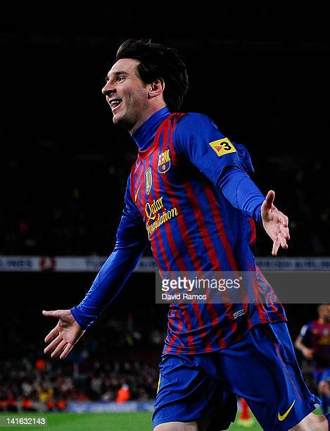 Lionel Messi of FC Barcelona celebrates after scoring his team's second goal during the La Liga match between FC Barcelona and Granada CF at Camp Nou...