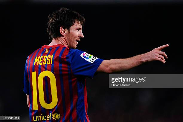 Lionel Messi of FC Barcelona celebrates after scoring his team's second goal during the La Liga match between FC Barcelona Athletic Club at Camp Nou...