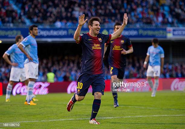 Lionel Messi of FC Barcelona celebrates after scoring his team's second goal during the La Liga match between RC Celta de Vigo and FC Barcelona at...