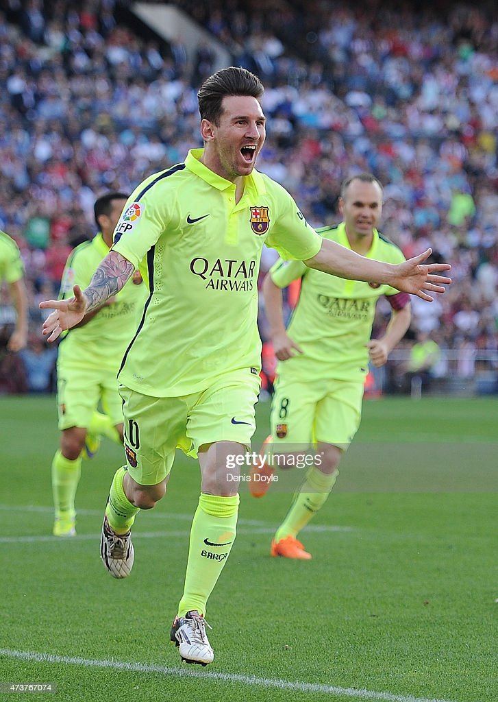 Lionel Messi of FC Barcelona celebrates after scoring his team's opening goal during the La Liga match between Club Atletico de Madrid and FC Barcelona at Vicente Calderon Stadium on May 17, 2015 in Madrid, Spain.