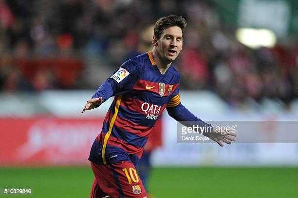 Lionel Messi of FC Barcelona celebrates after scoring his team's opening goal during the La Liga match between Sporting Gijon and FC Barcelona at...