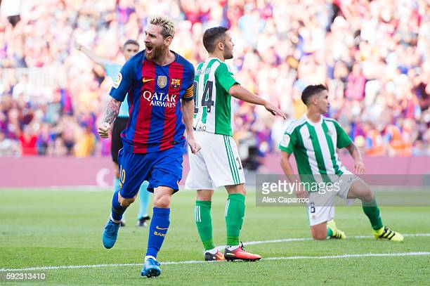 Lionel Messi of FC Barcelona celebrates after scoring his team's second goal during the La Liga match between FC Barcelona and Real Betis Balompie at...