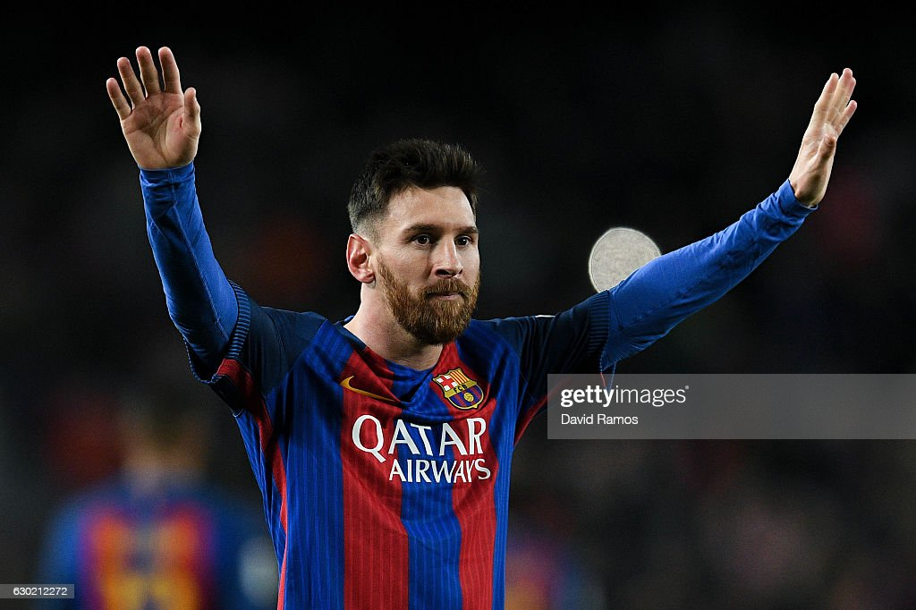 Lionel Messi of FC Barcelona celebrates after scoring his team's fourth goal during the La Liga match between FC Barcelona and RCD Espanyol at the Camp Nou stadium on December 18, 2016 in Barcelona, Spain.