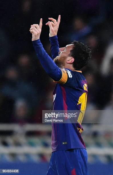 Lionel Messi of FC Barcelona celebrates after scoring his team's fourth goal during the La Liga match between Real Sociedad and FC Barcelona at...