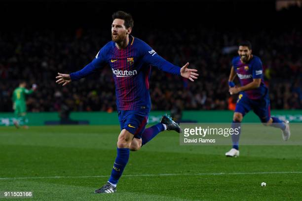 Lionel Messi of FC Barcelona celebrates after scoring his team's second goal during the La Liga match between Barcelona and Deportivo Alaves at Camp...