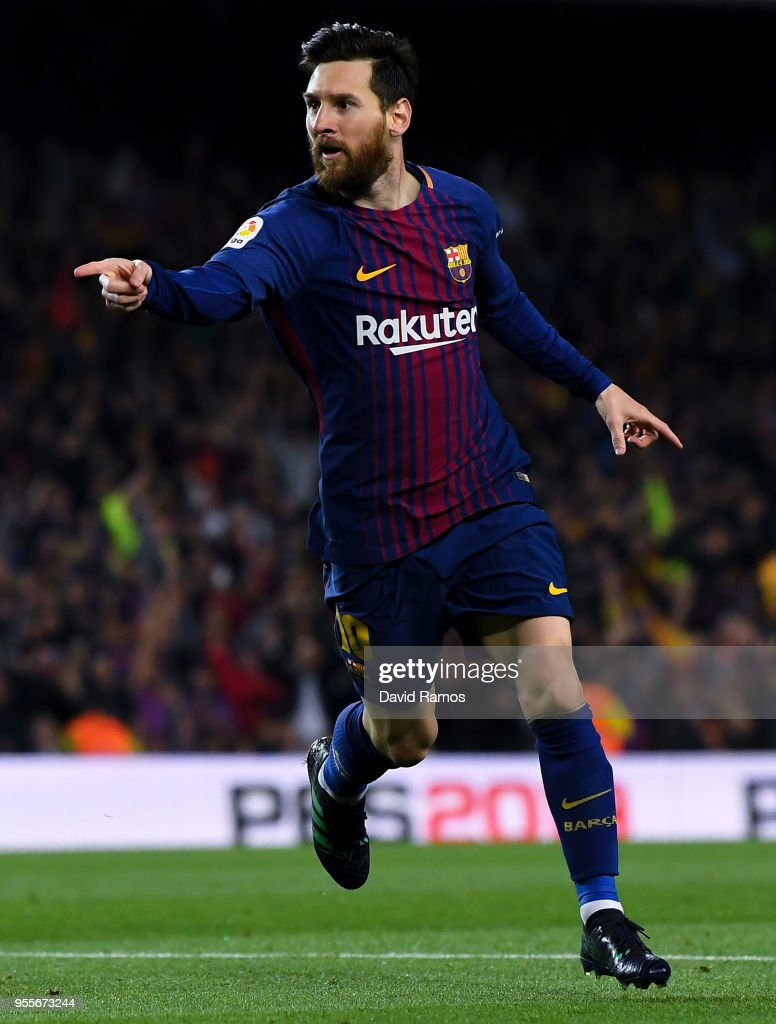 Lionel Messi of FC Barcelona celebrates after scoring his team's second goal during the La Liga match between Barcelona and Real Madrid at Camp Nou on May 6, 2018 in Barcelona, Spain.