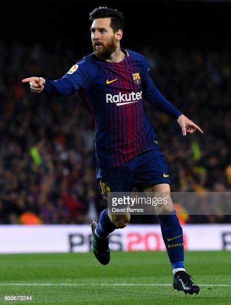 Lionel Messi of FC Barcelona celebrates after scoring his team's second goal during the La Liga match between Barcelona and Real Madrid at Camp Nou...
