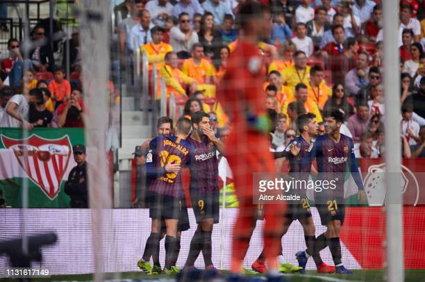 Lionel Messi of FC Barcelona celebrates after scoring his team's third goal during the La Liga match between Sevilla FC and FC Barcelona at Estadio...
