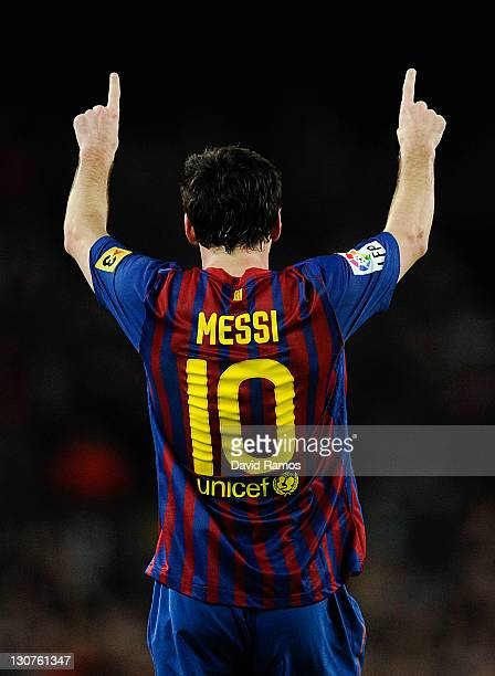 Lionel Messi of FC Barcelona celebrates after scoring his team's third goal during the La Lliga match between FC Barcelona and RCD mallorca at Camp...