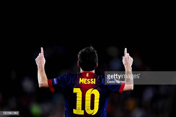 Lionel Messi of FC Barcelona celebrates after scoring his team's third goal during the UEFA Champions League Group G match between FC Barcelona and...