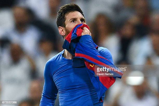 Lionel Messi of FC Barcelona celebrates after scoring his team's third goal during the La Liga match between Real Madrid CF and FC Barcelona at the...