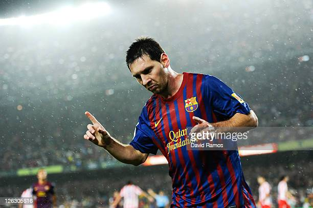 Lionel Messi of FC Barcelona celebrates after scoring his third team's goal during the La Liga match between FC Barcelona and Club Atletico de Madrid...