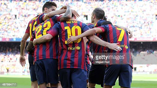 Lionel Messi of FC Barcelona celebrates after scoring the first goal with his teammates Pedro Rodriguez Andres Iniesta Dani Alves and Marc Bartra...
