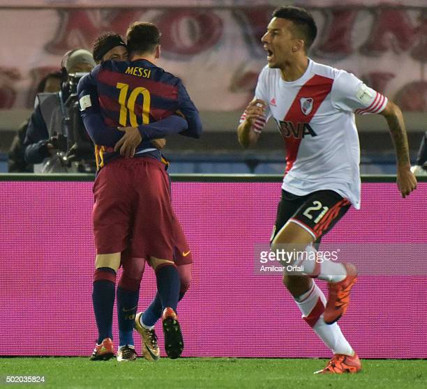 Lionel Messi of FC Barcelona celebrates after scoring the first goal of his team during the FIFA Club World Cup final match between River Plate and...
