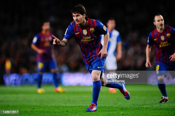Lionel Messi of FC Barcelona celebrates after scoring the opening goal during the La Liga match between FC Barcelona and RCD Espanyol at Camp Nou on...