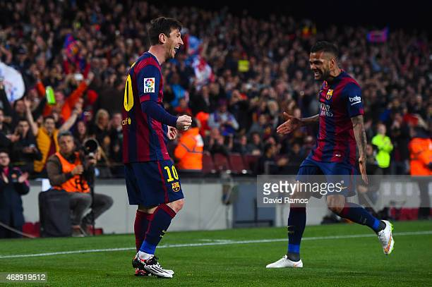 Lionel Messi of FC Barcelona celebrates after scoring the opening goal during the La Liga match between FC Barcelona and UD Almeria at Camp Nou on...